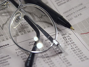 Glasses and a pen on top of loan modification numbers and percentages